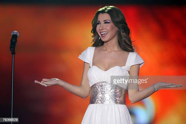 Lebanese singer Nancy Ajram performs during Qatar's ninth song festival in Doha late 25 January 2008 The festival is hosting several Arab pop and...
