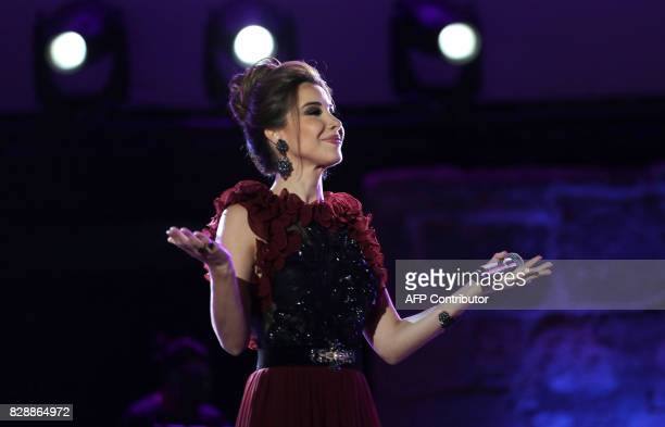 Lebanese singer Nancy Ajram performs during the 53rd session of the international Festival of Carthage at the Roman Theatre of Carthage in Tunis on...