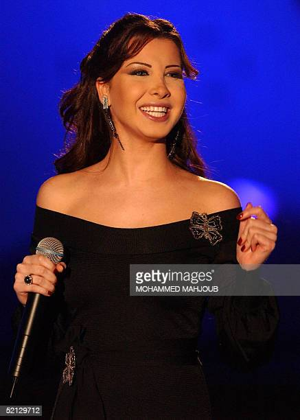 Lebanese singer Nancy Ajram performs during the Muscat 2005 Festival late 03 February 2005 AFP PHOTO/MOHAMMED MAHJOUB
