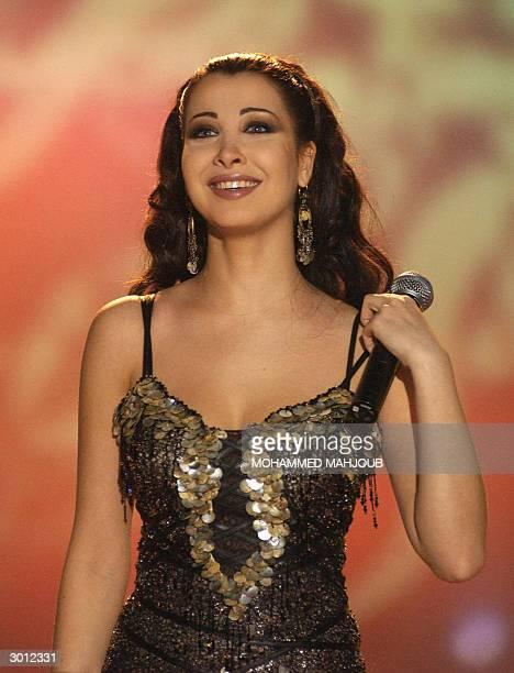 Lebanese singer Nancy Ajram performs in Muscat late 19 February 2004 AFP PHOTO/Mohammed MAHJOUB