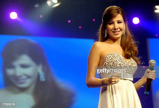 Lebanese singer Nancy Ajram performs late 12 October 2007 at the Mina alSalam hotel in Dubai during Music Plus TV gala during the first day of the...