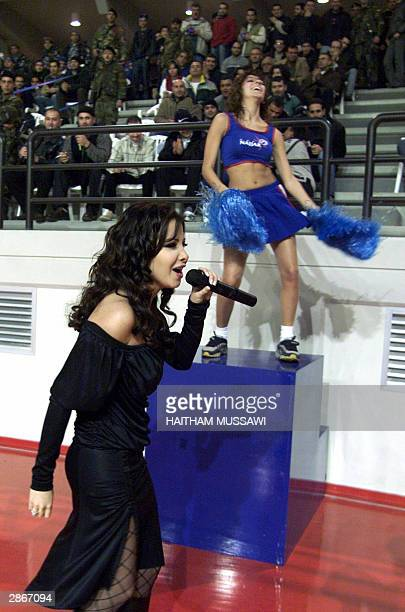 Lebanese singer Nancy Ajram performs late 13 January 2004 prior to a basketball game in Beirut AFP PHOTO/Haitham MUSSAWI