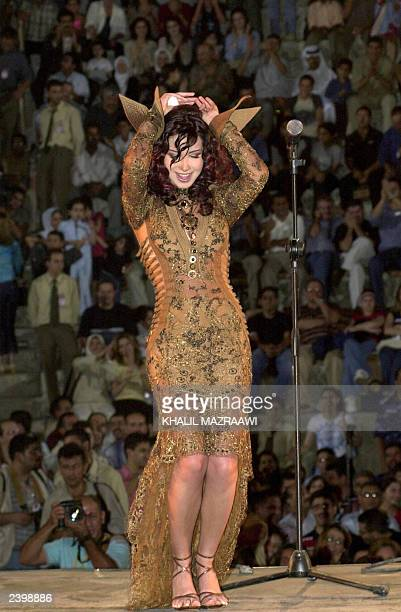 Lebanese singer Nancy Ajram preforms at the southern theater of Jarash north of Amman 09 August 2003 AFP PHOTO/Khalil MAZRAAWI