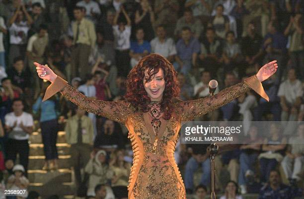 Lebanese singer Nancy Ajram preforms at the southern theater of Jarash north of Amman late 09 August 2003 AFP PHOTO/Khalil Mazraawi