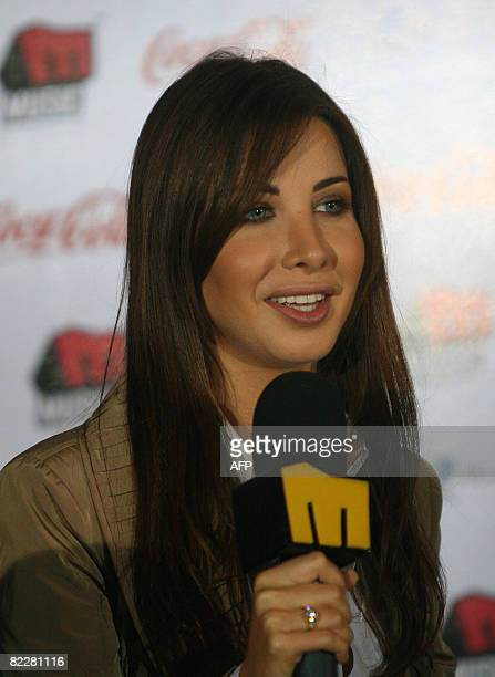 Lebanese singer Nancy Ajram speaks during a press conference to announce the launching of her new album 'Bitfakar fi Eih' in Cairo on August 12 2008...