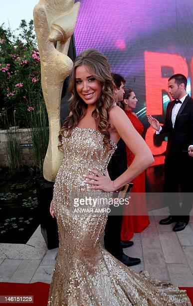 Lebanese singer Sabine arrives at the 2012 Murex d'Or awards ceremony in the ancient Lebanese port of Byblos north of the capital Beirut on June 10...
