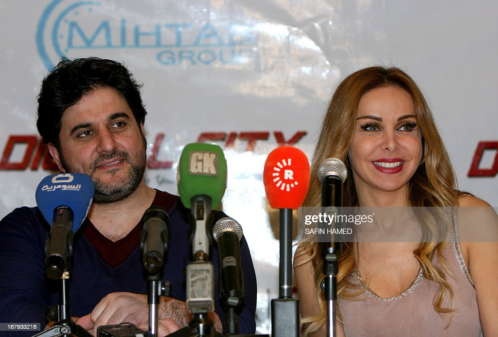 Lebanese singers Rola Saad (R) and Melhem Zein attend a press conference prior to their performance in the northern Iraqi city of Arbil on May 2, 2013.
