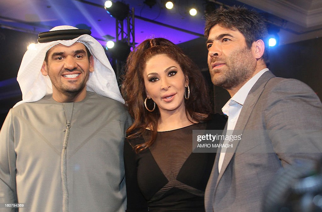 Lebanese singers Wael Kfoury (R) and Elissa (C) pose for a picture with Emirati singer Hussein al-Jasmi (L) during a press conference to announce the launching of the Egyptian version of the British music competition for aspiring singers 'X Factor', early on February 6, 2013 in Cairo.