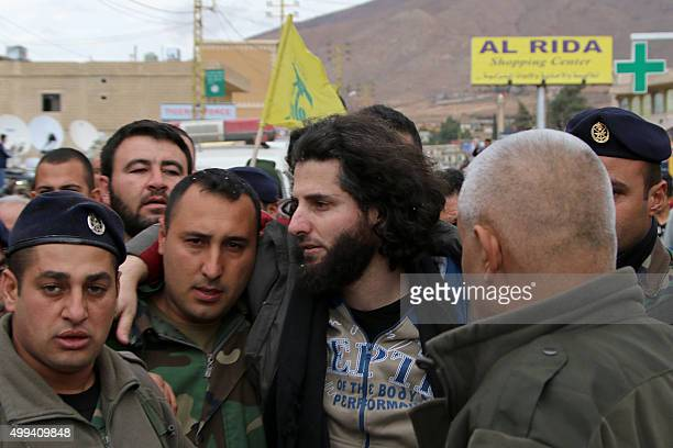 A Lebanese soldier helps a fellow member of the security forces who has been kidnapped by jihadist groups from the eastern border town of Arsal last...