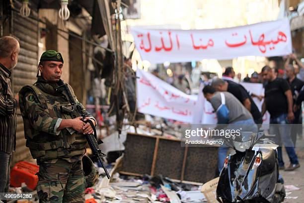 Lebanese soldier stands guard at an area where two explosions took place at Dahieh know as Hezbollah stronghold South Beirut Lebanon on November 13...