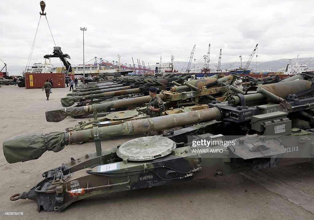 A Lebanese soldier stands next to M198 155mm howitzers upon the arrival of a shipment of US weapons at the Beirut port on February 8 2015 The...