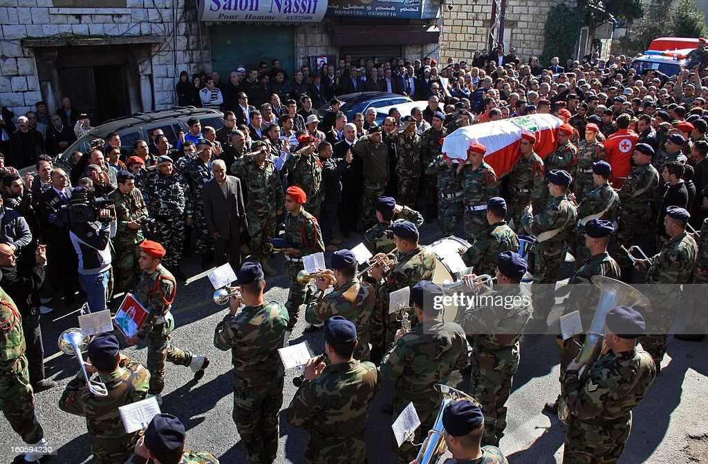 Lebanese soldiers carry the coffin of Lebanese army captain Pierre Bashalana, one of the two soldiers who were killed in a clash with unidentified gunmen in Arsal, a village near the border with Syria, during his funeral procession in the city of Mraijat, on the outskirts of Beirut, on February 3, 2013. Bashalana was killed alongside sergeant Ibrahim Zahrman while several others were wounded in the clash with an unspecified number of gunmen, who also sustained casualties on February 1.