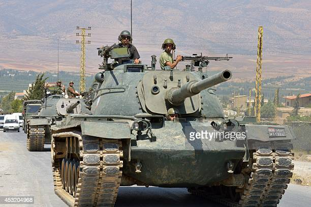 Lebanese soldiers enter the town of Arsal near the Syrian border as they head to fight Islamist militants on August 5 2014 on the fourth day of...