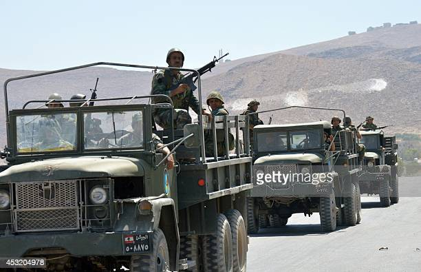 Lebanese soldiers exit the town of Arsal near the Syrian border on August 5 on the fourth day of fierce fighting against Islamist militants in the...