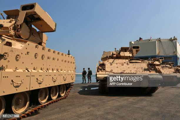 Lebanese soldiers guard US made Bradley Fighting Vehicles at the port of Beirut on August 14 2017 The US Army is sending a total of 50 Bradley...