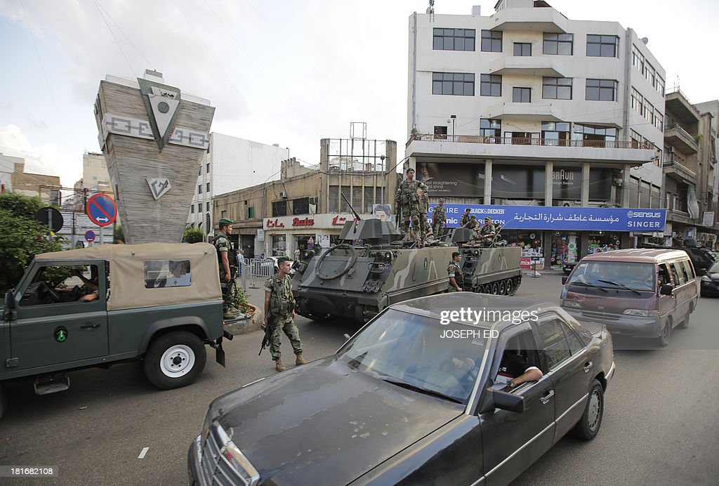 Lebanese soldiers man a checkpoint in the southern suburb of the capital Beirut on September 23, 2013. Lebanese troops are to take over security at checkpoints set up by the Hezbollah movement in their southern Beirut stronghold after two bombings, the interior minister told AFP.