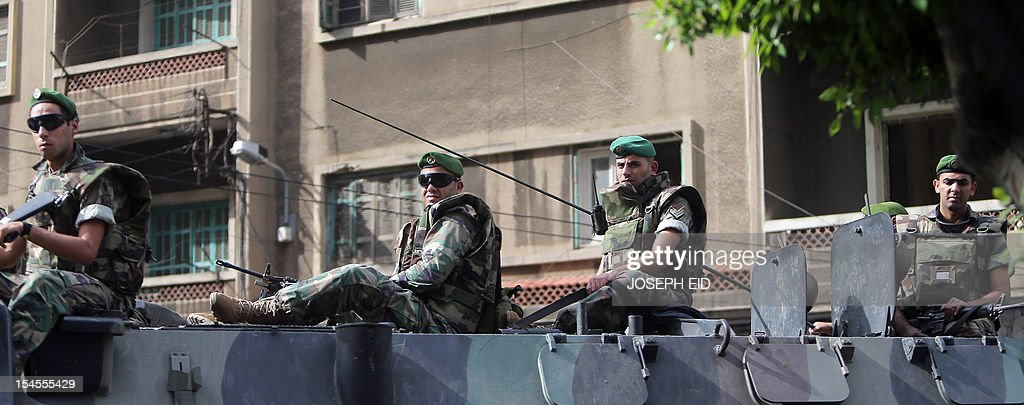 Lebanese soldiers monitor a street in the northern city of Tripoli on October 22, 2012. Lebanon's army said it was determined to restore order in the country, roiled by growing political tensions linked to Syria after a top policeman was murdered and former premier Saad Hariri called for the government to step down. AFP PHOTO/JOSEPH EID