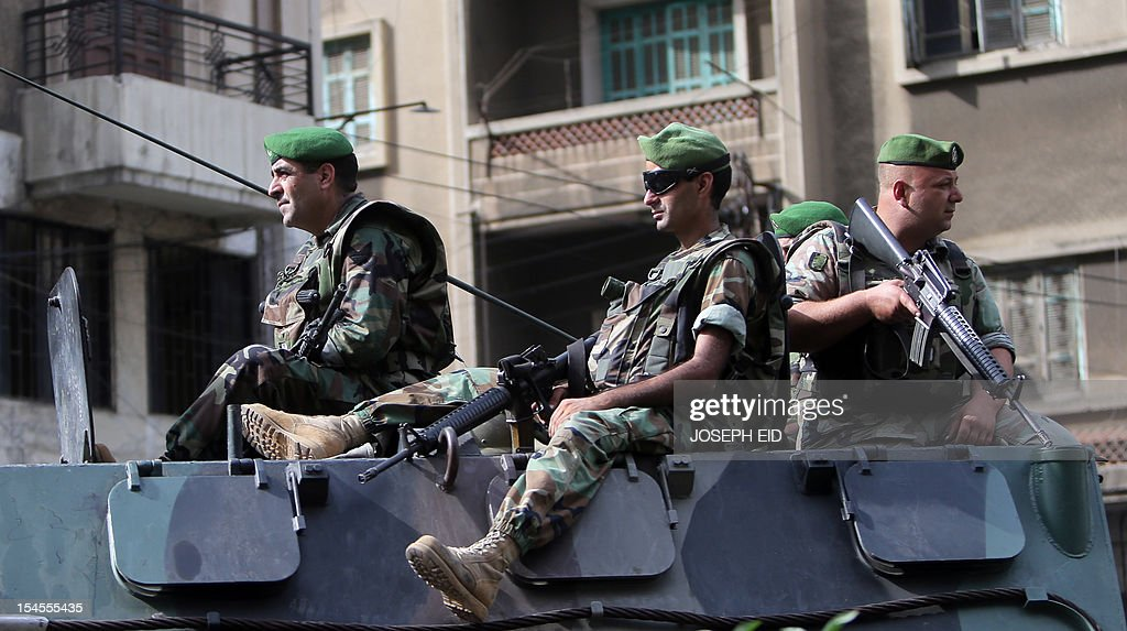 Lebanese soldiers patrol a street in the northern city of Tripoli on October 22, 2012. Lebanon's army said it was determined to restore order in the country, roiled by growing political tensions linked to Syria after a top policeman was murdered and former premier Saad Hariri called for the government to step down. AFP PHOTO/JOSEPH EID