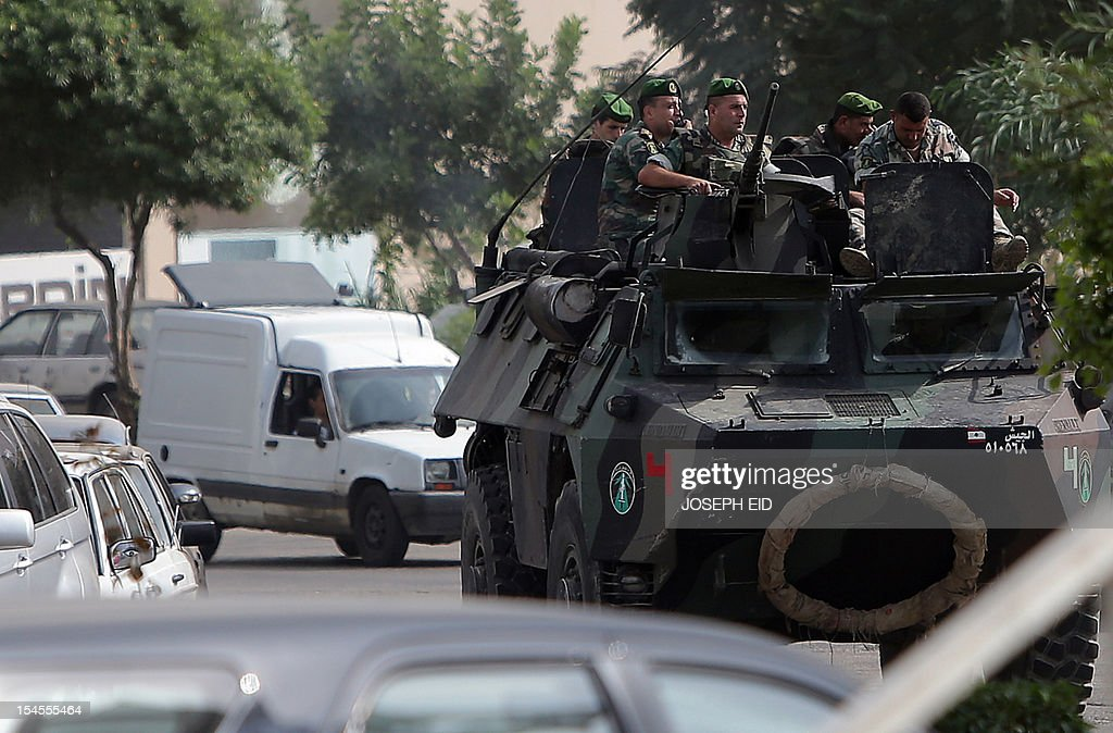 Lebanese soldiers patrol a street in the northern city of Tripoli on October 22, 2012. Lebanon's army said it was determined to restore order in the country, roiled by growing political tensions linked to Syria after a top policeman was murdered and former premier Saad Hariri called for the government to step down.