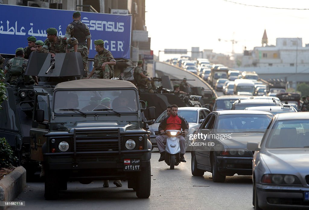 Lebanese soldiers prepare to install a checkpoint in the southern suburb of the capital Beirut on September 23, 2013. Lebanese troops are to take over security at checkpoints set up by the Hezbollah movement in their southern Beirut stronghold after two bombings, the interior minister told AFP.