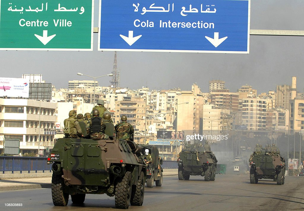 Lebanese soldiers ride on their armoured vehciles towards a neighborhood in the capital Beirut during a demonstration in support of the caretaker prime minister Saad Hariri on January 25, 2011, as hundreds of people converged on the northern city of Tripoli to take part in a 'day of rage' over the likely appointment as prime minister of Hezbollah-backed tycoon Najib Mikati.
