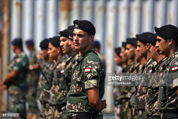 Lebanese soldiers stand guard as US made Bradley Fighting Vehicles are being delivered at the port of Beirut on August 14 2017 The US Army is sending...