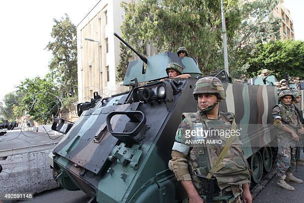 Lebanese soldiers stand guard outside the Russian embassy during a protest organised by members of the Sunni Committee of Muslim Scholars against...