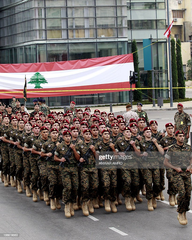 Lebanese special forces march past a giant national flag during a military parade marking Lebanon's 69th Independence Day in central Beirut on November 22, 2012. Lebanon, a former French mandate, won its independence on November 22, 1943, ending a two-decade rule by France. AFP PHOTO / ANWAR AMRO