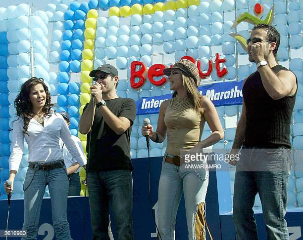 Lebanese Stars from left Nancy Ajram Uri Murkadi Dina Hayek and Joe Ashkar perform at the start of the Beirut International Marathon 19 October 2003...