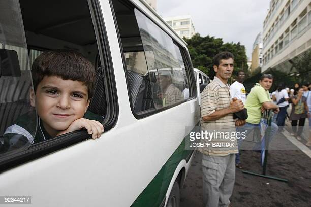 A Lebanese student looks from the window of his school bus as he waits for others to go home at the end of a school day at the International College...