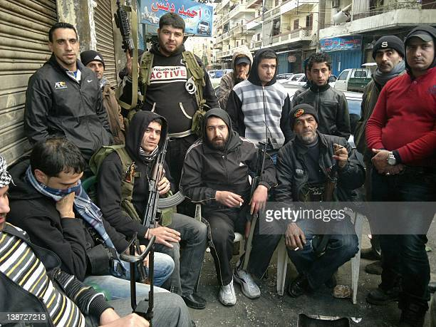 Lebanese Sunni militants of 'Ansar' supporters of the antiSyrian opposition pose while securing an alley in the neighbourhood of Baba alTabbaneh in...