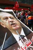 Lebanese supporters and members of the Islamic group Jamaa Islamiya deploy a giant portrait of Turkish President Recep Tayyip Erdogan during a...