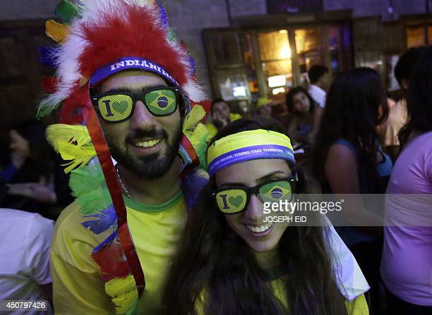 Lebanese supporters of Brazil follow on a screen the football match between Brazil and Mexico in the FIFA World Cup 2014 at a pub in the historical...
