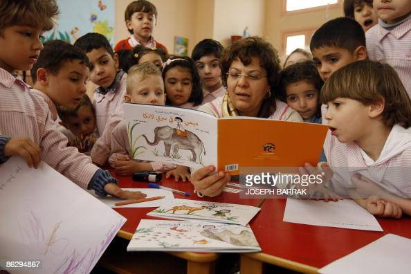 Lebanese teacher reads to her students at a school in Beirut on April 29 a series of children's books launched this week in Lebanon to coincide with...