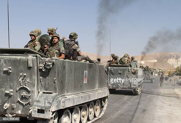 Lebanese troops deploy in the eastern town of Arsal near the Syrian border on August 28 2014 Lebanese troops clashed with gunmen today in the mainly...