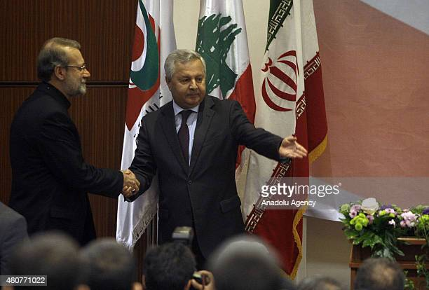 Lebanese University Rector Adnan Seyyid Huseyin welcomes Speaker of Iran's parliament Ali Larijani when Larijani arrives to deliver a speech at...