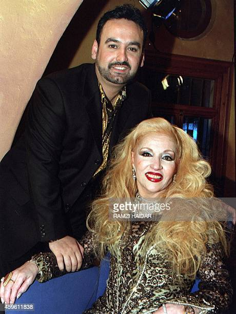 Lebanese veteran singer Sabah poses for a picture with her husband Fadi Lubnan during a television interview in Beirut late 21 March 2000 Sabah who...