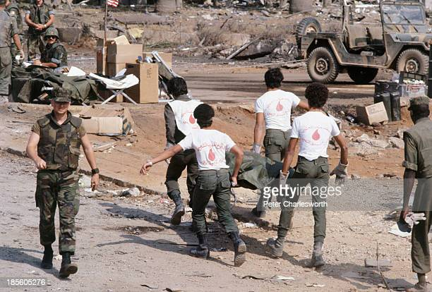 Lebanese volunteer rescue workers carry the body of an American Marine from the rubble of the American Marines Barracks that was attacked by a...
