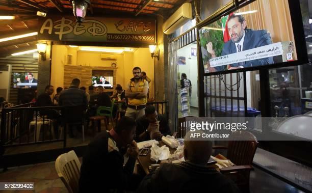 TOPSHOT Lebanese watch an interview with Lebanon's resigned prime minister Saad Hariri at a coffee shop in Beirut on November 12 2017 Saad Hariri...