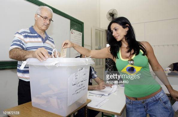 A Lebanese woman casts her ballot during the second round of the municipal elections in Beirut on May 9 2010 The second round of Lebanon's municipal...