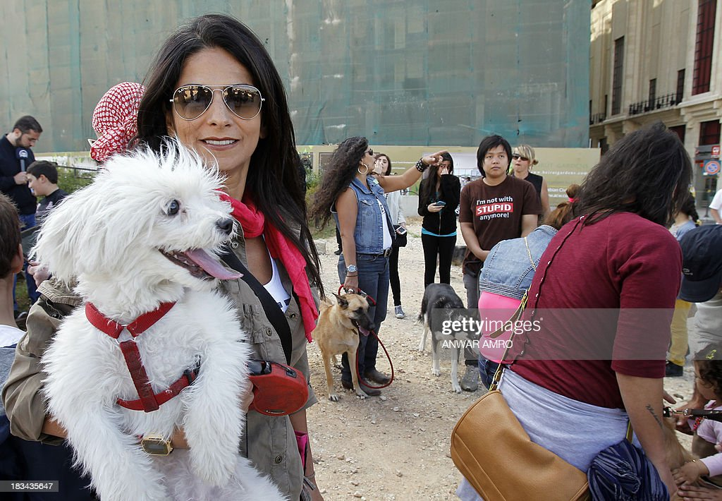 A Lebanese woman holds her dog in Martyr's Square in downtown Beirut at the start of march along the Corniche organised by Beirut for the Ethical Treatment of Animals (BETA) on October 6, 2013 in support of the improvement of animal welfare in the region and to stop abuse against them.