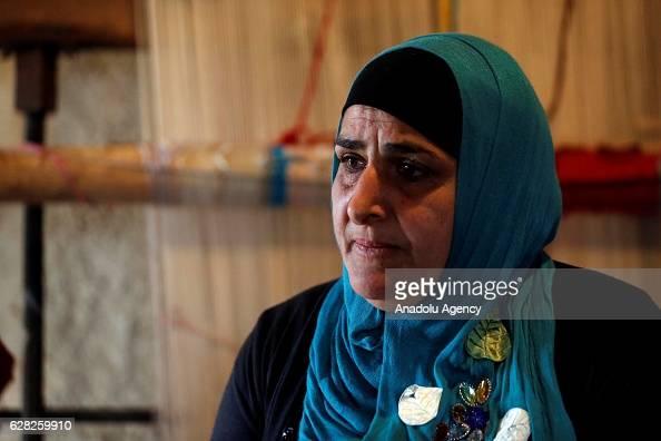Lebanese woman Joreyah Meslmani works at carpet weaving workshop at Al Fakeha Village of Beqaa Lebanon on November 30 2016 Carpet weaving craft that...