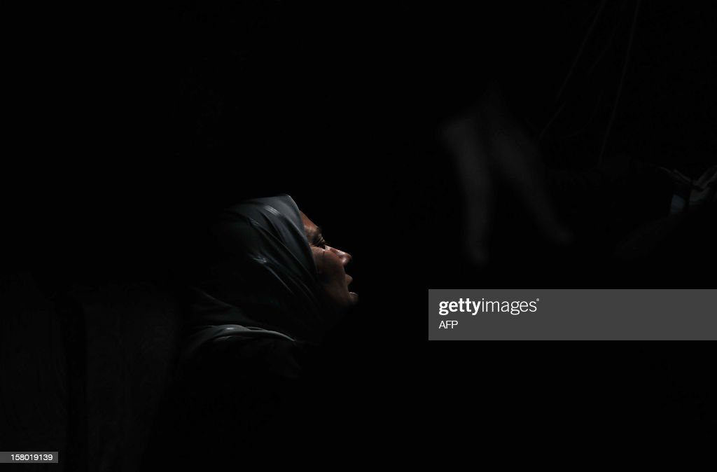A Lebanese woman mourns during the funeral of Khodr Mustafa Alameddine, who was among a group of Sunni Muslims killed by the Syrian army after they crossed into Syria to fight alongside rebels, in Minieh in northern Lebanon on December 9, 2012. The 22 men died in Tal Kalakh in the central Syrian province of Homs late last month after travelling from the northern Lebanese city of Tripoli to join the rebellion against Syrian President Bashar al-Assad, according to a local official and an Islamist leader.