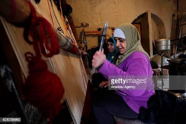 Lebanese woman Nahla Sukaria works at carpet weaving workshop at Al Fakeha Village of Beqaa Lebanon on November 30 2016 Carpet weaving craft that...
