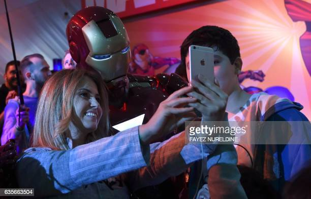 A Lebanese woman poses for a selfie with a man dressed up as 'Iron Man' during Saudi Arabia's first ever ComicCon event in the coastal city of Jeddah...