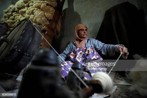 Lebanese woman Um Khaled Harbi works at carpet weaving workshop at Al Fakeha Village of Beqaa Lebanon on November 30 2016 Carpet weaving craft that...