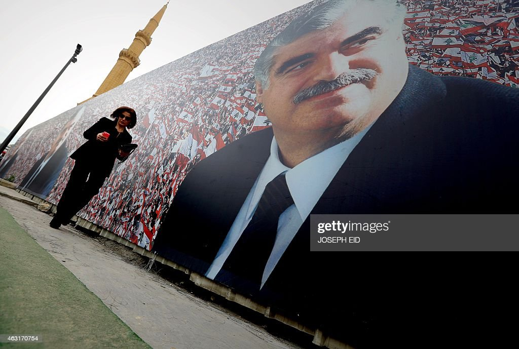 A Lebanese woman walks past a giant poster showing slain Lebanese prime minister <a gi-track='captionPersonalityLinkClicked' href=/galleries/search?phrase=Rafiq+Hariri&family=editorial&specificpeople=549773 ng-click='$event.stopPropagation()'>Rafiq Hariri</a> on February 6, 2015 in central Beirut on the tenth anniversary of his death. 'Ten years, 100 years, 1,000 years, we will stay faithful to you' read the billboards going up around Beirut a decade after Lebanon was upended by Hariri's assassination.