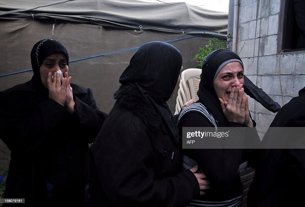Lebanese women mourn during the funeral of Khodr Mustafa Alameddine, who was among a group of Sunni Muslims killed by the Syrian army after they crossed into Syria to fight alongside rebels, in Minieh in northern Lebanon on December 9, 2012. The 22 men died in Tal Kalakh in the central Syrian province of Homs late last month after travelling from the northern Lebanese city of Tripoli to join the rebellion against Syrian President Bashar al-Assad, according to a local official and an Islamist leader.