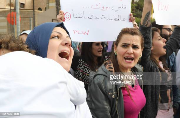 Lebanese women take part in a protest in front of Lebanon's Supreme Shiite Council to ask clerics to increase the age at which custody of children...