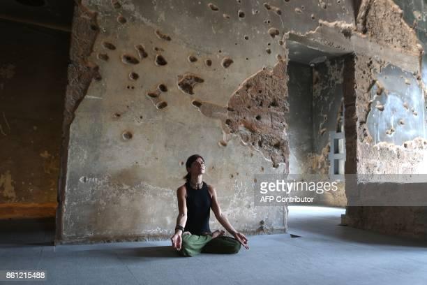 Lebanese Yogi Danielle Abi Saab practises Yoga in Beit Beirut on October 14 during an installation dubbed Healing Lebanon by local artist Zena...